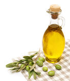 Azeite e ramo de oliveira isolados no branco Fotografia de Stock Royalty Free