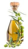 Azeite na garrafa e nas azeitonas Imagens de Stock