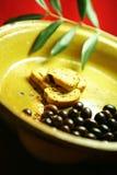 Azeitonas e bruschette Fotografia de Stock