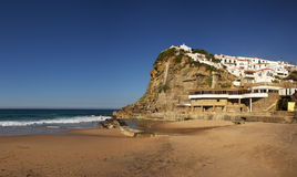 Azenhas do Mar. Beach and village seen from water level. Sintra, Portugal stock photo