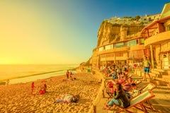 Azenhas do Mar beach. Azenhas do Mar, Portugal - August 5, 2017: tourists sunbathing and relaxing on famous beach of Azenhas do Mar in Colares, Atlantic Coast royalty free stock image