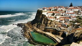 Azenhas do Mar village and natural swimming pool. Beautiful Azenhas do Mar village perspective with white houses and natural swimming pool in Portugal nature stock photos