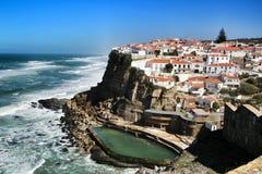 Azenhas do Mar village and natural swimming pool. Azenhas do Mar, Sintra, Lisbon, Portugal- March 19, 2019: Beautiful Azenhas do Mar village perspective with stock image