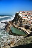 Azenhas do Mar village and natural swimming pool. Azenhas do Mar, Sintra, Lisbon, Portugal- March 19, 2019: Beautiful Azenhas do Mar village perspective with stock photo