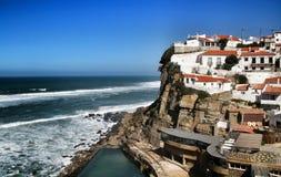 Azenhas do Mar village and natural swimming pool. Azenhas do Mar, Sintra, Lisbon, Portugal- March 19, 2019: Beautiful Azenhas do Mar village perspective with royalty free stock photos