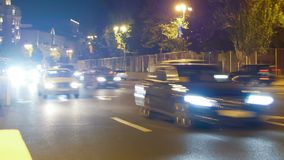 Night Traffic in the City. Cars Drive with Lights on Night Road. Time Lapse. AZERBAIJAN, BAKU, MAY 9, 2017: Night Traffic in the City. Cars Drive with Lights on stock footage