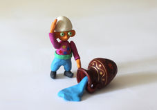 Azerbaijan fairytale character - Dzhyrtdan. Little trikster boy made from color plasticine, spill Royalty Free Stock Photo