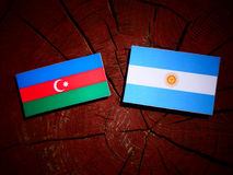 Azerbaijan flag with Argentinian flag on a tree stump  Stock Photo