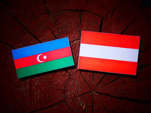 Azerbaijan flag with Austrian flag on a tree stump  Royalty Free Stock Photo
