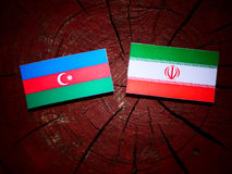 Azerbaijan flag with Iranian flag on a tree stump isolated Stock Photos
