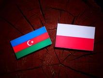Azerbaijan flag with Polish flag on a tree stump isolated. Azerbaijan flag with Polish flag on a tree stump vector illustration
