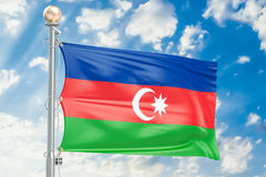 Azerbaijan flag waving in blue cloudy sky, 3D rendering Stock Image