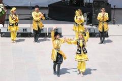 Azerbaijan folk dance. ISTANBUL - APRIL 23: Azerbaijan group perform folk dance during National Sovereignty and Children Day festival at Maltepe University on Stock Photos