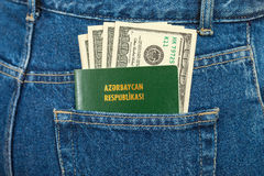 Azerbaijan passport and dollar bills Stock Photo