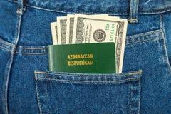Azerbaijan passport and dollar bills Stock Photo