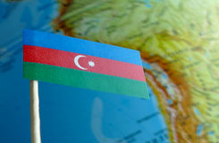 Azerbaijani flag with a globe map as a background Stock Photo