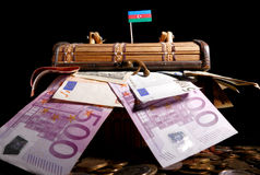 Azerbaijani flag on top of crate. Full of money Royalty Free Stock Photography