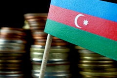 Azerbaijani flag waving with stack of money coins Stock Images