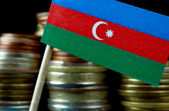 Azerbaijani flag waving with stack of money coins Royalty Free Stock Image