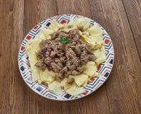 Azerbaijani Guru Khingal. Caucasian pasta with fried chopped meat Stock Photography