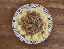 Azerbaijani Guru Khingal. Caucasian pasta with fried chopped meat Stock Photos