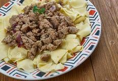 Azerbaijani Guru Khingal. Caucasian pasta with fried chopped meat Stock Photo