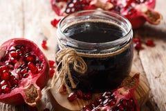 Azerbaijani seasoning Narsharab sauce made from pomegranate juice in a jar close-up. horizontal royalty free stock photo