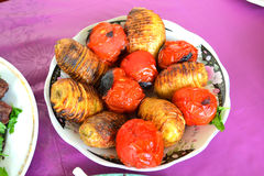 Azerbaijani skewers of potatoes and tomatoes Royalty Free Stock Images