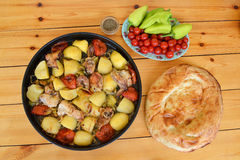 Azerbaijani Tava kebab. Cooked in a pan of chicken kebab with potatoes and tomatoes Royalty Free Stock Photography