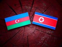 Azerbejdżan flaga z koreańczyk z korei północnej flaga na drzewnym fiszorku Zdjęcia Royalty Free