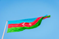 Azeri flag on the pole in wind. Azeri flag waving in wind at National flag square, Baku, Azerbaijan Royalty Free Stock Images
