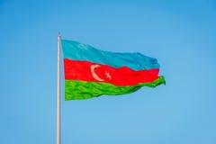 Azeri flag on the pole in wind. Azeri flag waving in wind at National flag square, Baku, Azerbaijan Stock Photos