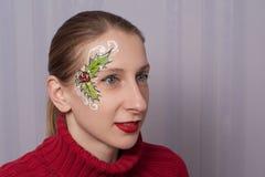 Azevinho do Natal que facepainting Fotografia de Stock Royalty Free