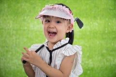 Aziatisch Chinees meisje speelgolf Royalty-vrije Stock Foto