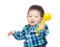 Aziatisch het spelstuk speelgoed van de babyjongen royalty-vrije stock foto's