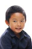 Aziatisch jongens blauw overhemd stock foto