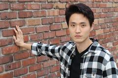 Aziatisch mannetje die neutrale uitdrukkingsclose-up met exemplaarruimte tonen stock foto's