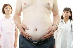 Aziatisch medisch personeel met geduldige zwaarlijvigheid stock foto