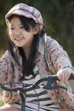 Aziatisch meisje Biking Stock Afbeeldingen