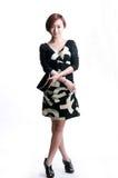 Aziatisch meisje die een beurs houden Stock Foto's