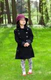 Aziatisch meisje in een tuin Royalty-vrije Stock Afbeeldingen