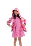 Aziatisch meisje in jasje met kap op wit Royalty-vrije Stock Afbeeldingen