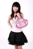 Aziatisch meisje met handtas Royalty-vrije Stock Afbeelding