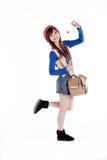 Aziatisch meisje met reiszak Royalty-vrije Stock Afbeeldingen