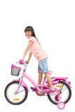 Aziatisch meisje op fiets Royalty-vrije Stock Afbeelding