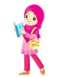 Aziatisch moslimmeisje met boek Stock Afbeeldingen