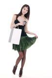 Aziatisch winkelend meisje stock foto's