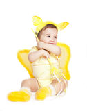 Aziatische babyjongen in een geel kostuum Stock Foto's