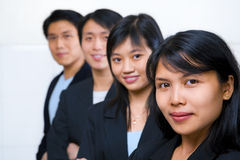 Aziatische bedrijfsmensenopstelling Stock Foto's