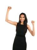 Aziatische bedrijfsvrouw die een triomf vieren Stock Foto